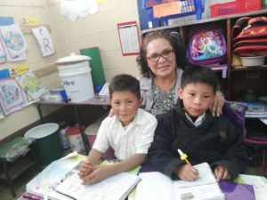 Guatemalan teacher and students